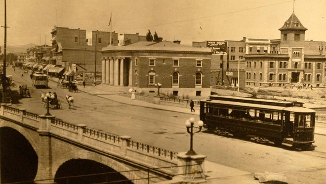A trolley car moves across the relatively-new Virginia Street Bridge in this circa 1910 photo.