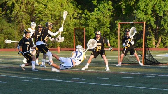 Mahopac goalie Mike Argila draws a flag while attempting