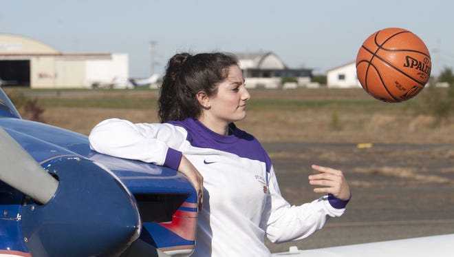 Girls high school basketball player Jess Louro of St Rose at Wall Airport.