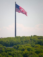 As seen from the Sheboygan County Historical Museum grounds, the flag of the United States flutters in the wind at Acuity, Thursday, June 5, 2018, in Sheboygan, Wis. Standing 400 feet tall, the Acuity Insurance Flagpole is the world's largest free-flying American flag.