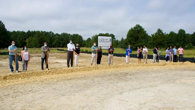 Members of the Sweven Investment Group, Dewitt Tilton Group and Pooler leaders broke ground for the Kansa Center Development on Tuesday.