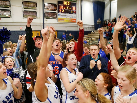 Players and students from Carroll High School celebrate after defeating Central Catholic 35-30 to win sectional #38 Saturday, February 4, 2017, in Lafayette.