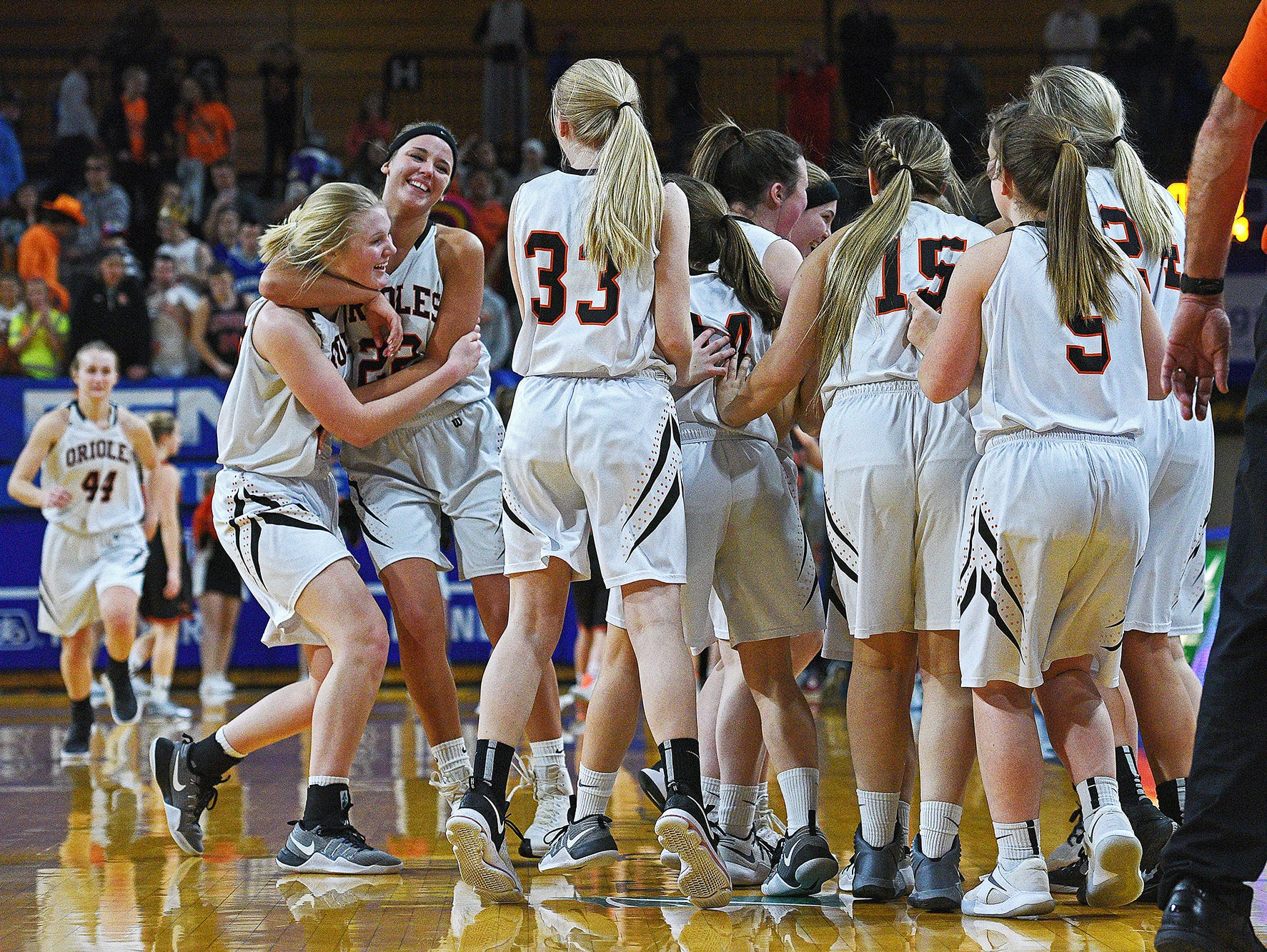 Lennox players celebrate their 63-58 win over Dell Rapids in a 2017 SDHSAA Class A State Girls Basketball Tournament quarterfinal game Thursday, March 9, 2017, at Frost Arena on the South Dakota State University campus in Brookings, S.D.