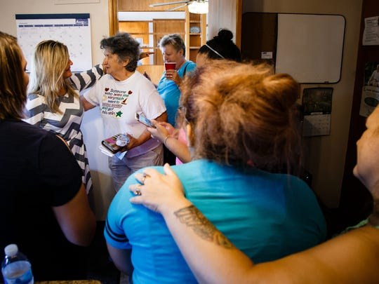 Oak Place staff member Lisa Belden of Moravia, left, hugs former client Joan Conn before she leaves after having lunch at the house on Wednesday, Aug. 30, 2017, in Centerville. Oak Place, a crisis-stabilization home for people in mental crises, has been lauded both locally and nationally for its work.