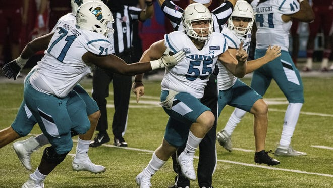 Coastal Carolina players celebrate after place kicker Massimo Biscardi (29) kicked the go-ahead and eventual game-winning 40-yard field goal with 4 seconds remaining to beat No. 21 Louisiana 30-27 on Wednesday night in Lafayette, La..