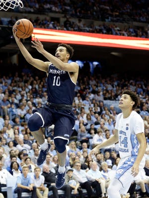 Monmouth's Micah Seaborn (10) drives to the basket as North Carolina's Justin Jackson (44) chases during the second half of an NCAA college basketball game in Chapel Hill, N.C., Wednesday, Dec. 28, 2016. North Carolina won 102-74. (AP Photo/Gerry Broome)