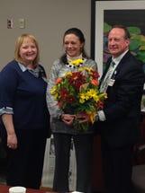 Priscilla VanDewark, manager of Guthrie Corning Hospital, ICU, left, and Garrett Hoover, president of Guthrie Corning Hospital,  congratulate Angie Burlew, center.