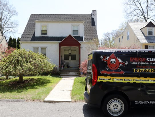 A cleaning van outside the home of Gabriella Maria