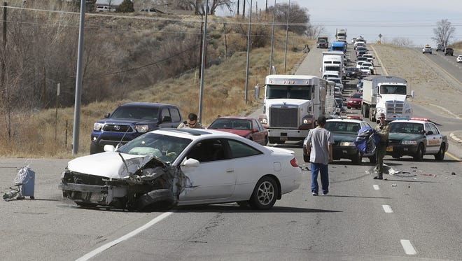 Police on Friday investigate a two-car crash near milemarker 39 on U.S. Highway 64.