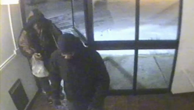 Surveillance video shows James Shaw entering with an unidentified male, who police say is a suspect in his murder.