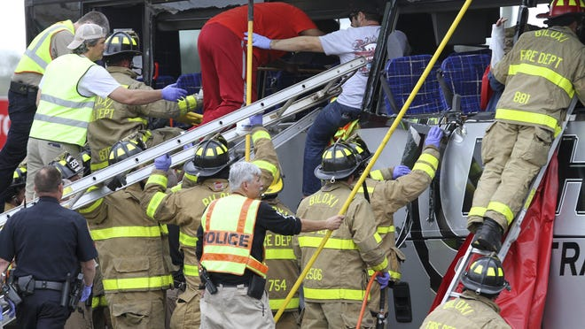 A handout photo made available by The Sun Herald shows rescue personnel tend to those injured when a CSX freight train hit a charter bus that reportedly left four people dead and 35 people hospitalized in Biloxi, Mississippi, USA, 07 March 2017. According to reports, the bus from Austin Texas carrying mostly senior citizens was traveling from a casino in Bay St. Louis, Mississippi to a casino in Biloxi when it was hit and pushed 300 feet (91.4 meters) down the tracks. The three-locomotive, 52 car train was traveling from New Orleans, Louisiana to Mobile, Alabama.
