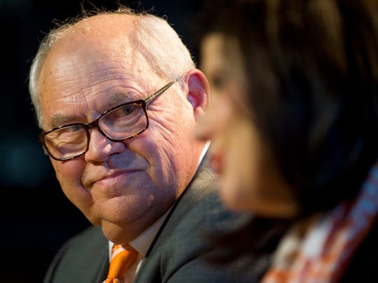 Phillip Fulmer looks over as University of Tennessee Chancellor Beverly Davenport speaks during a press conference, Friday, Dec. 1, 2017, in Knoxville, Tenn., where Fulmer was named athletic director. The university placed former AD John Currie on paid leave amid what has been a tumultuous and embarrassing football coaching search. (Calvin Mattheis/Knoxville News Sentinel via AP)