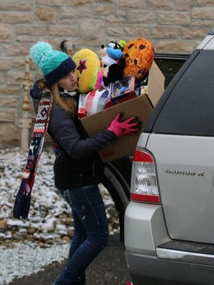 Indian Valley students helped unload donations for Share-A-Christmas during the 2018 event in the parking lot at WJER.