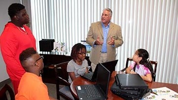 The St. Lucie County Board of County Commissioners recently donated six used laptops to END IT (Everybody's Not Doing It) – a local nonprofit focused on providing positive peer pressure to teens and pre-teens. Here Commissioner Chris Dzadovsky presents the laptops to a group of END IT participants.