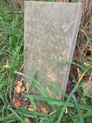 An old gravestone in the Clarke Cemetery marks the