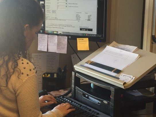 Amber Ferrell records the weight and type of solid
