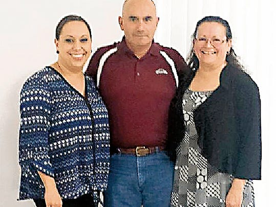 Submitted Photo   Deming City Councilor Roxana Rincon, left, Deming Mayor Benny Jasso and Marisol Perez, program director for the Deming Literacy Center, are celebrating 25 years of the center serving Deming.
