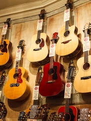 In this Jan. 10, 2016 photo, guitars hang from the