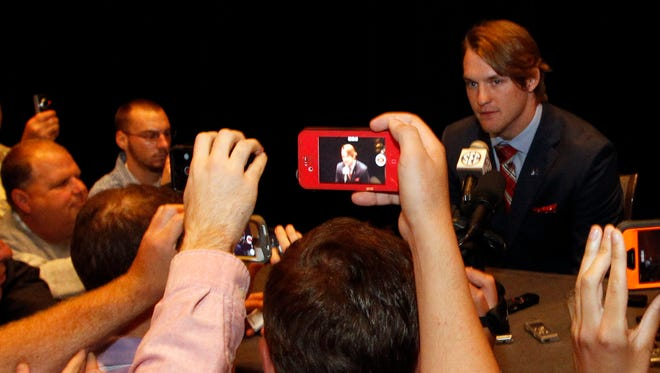 Mississippi quarterback Bo Wallace speaks to media at the Southeastern Conference NCAA college football media days on Thursday, July 17, 2014, in Hoover, Ala. (AP Photo/Butch Dill)