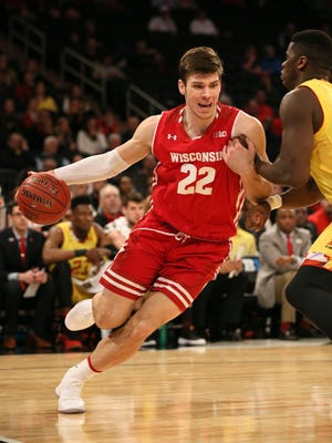 UW forward Ethan Happ drives to the basket against Maryland in a Big Ten tournament game Thursday.