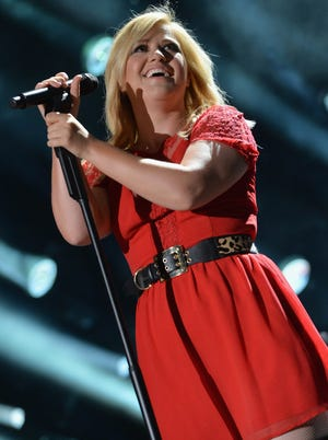 Kelly Clarkson is 'Wrapped in Red.'