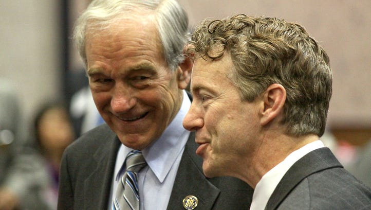 Former Rep. Ron Paul of Texas and his son, Kentucky Sen. Rand Paul, during a 2010 campaign fundraiser for Rand Paul for U.S. Senate at the Kentucky Fair and Exposition Center.