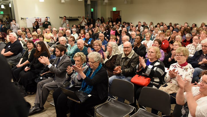 The audience applauds a speaker during Thursday's standing-room-only town hall at the Novi Public Library. Organizers said they want U.S. Rep. David Trott, R-Birmingham, to meet in person with constituents.