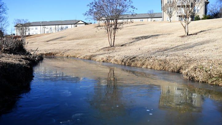 Creek freezes in downtown Jackson