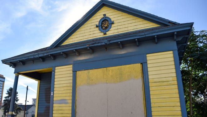 The former Stained Glass Pub on Fourth Street stands in a large empty lot. The building was cut in half several years ago. It now shelters feral cats and a few people who sleep around the building or on the porch.
