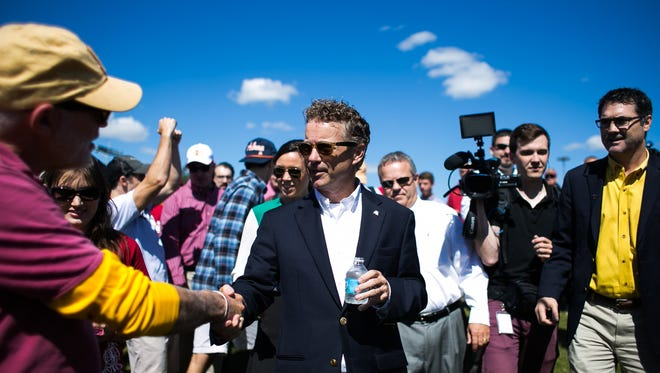 Republican Presidential candidate Rand Paul campaigning during the tailgate before the Cy-Hawk game at Iowa State University in Ames on Saturday, September 12, 2015.