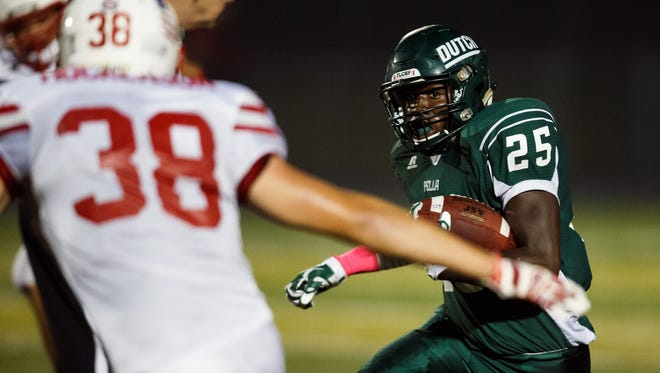 Pella's Nathan Henry rushes during their game in Pella, Iowa on Friday, Oct. 23, 2015.