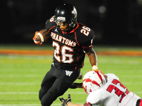 West De Pere running back Dom Conway turns the corner against Syemour's Clayton VanLanen.