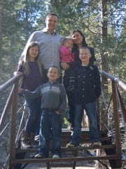 The German family from Exeter: Garrett (top) and his wife Becka with their children Bethany (10), Ethan (9), Wyatt (6) and Karis (3).