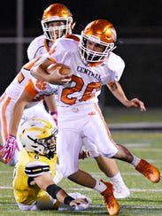 Central York's Mason Myers runs the ball while Red