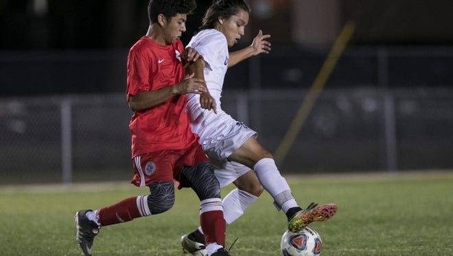 Anthony Chinchilla, right, of Cypress Lake keeps the ball from Kevin Leon of South Fort Myers on Thursday at Cypress Lake High School.