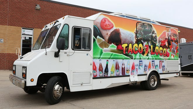 The Taco Loco food truck sits in the parking lot at Confluence Brewery in Des Moines on Thursday, April 2, 2015.