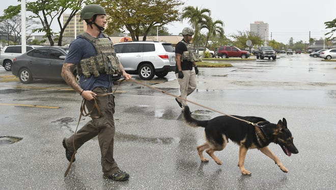 In this file photo, an Air Force security K-9 unit responds to a bomb threat at the Agana Shopping Center.
