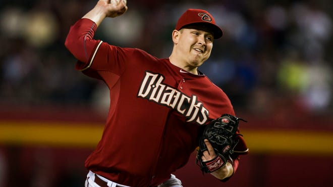 Diamondbacks pitcher Trevor Cahill throws against the San Francisco Giants at Chase Field.