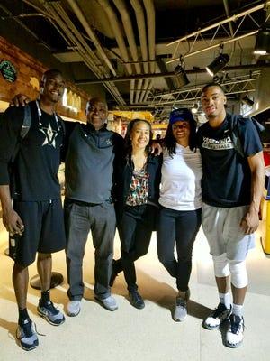 Vanderbilt basketball player Joe Toye (far right) poses with, from left, teammate Djery Baptiste, father Matthew Toye, mother Janyth Toye and twin sister Elizabeth Toye.