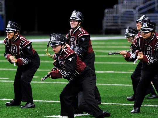 Members of the Bronte High School Longhorn Band pantomime