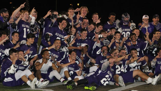 The Old Bridge boys lacrosse team celebrates winning the GMC Tournament final on Monday, May 15, 2017.