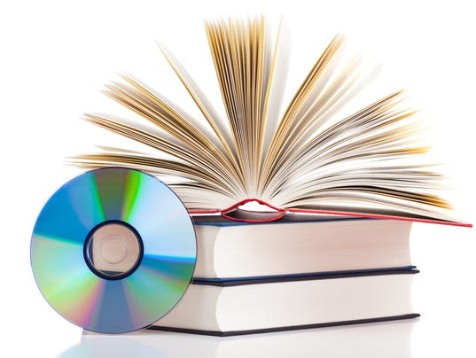 Pile of books and a CD on a white surface