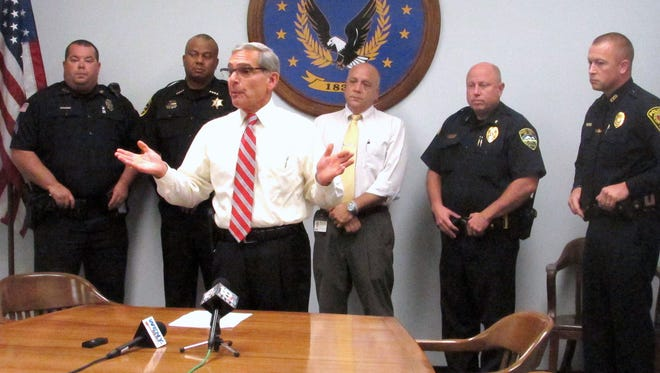 Chemung County Executive Tom Santulli, foreground, announces the purchase of 130 new radios for county law enforcement agencies. Joining Santulli are, from left, Sgt. Dan West of the Horseheads Police Department, Chemung County Sheriff Christopher Moss, county Emergency Management Director Mark Cicora, Elmira Heights Police Chief Russell Hauptman and Elmira Police Chief Joseph Kane.