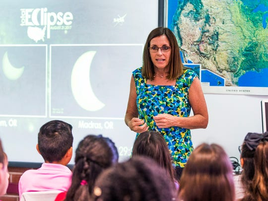 Rep. Martha McSally explains the eclipse to students
