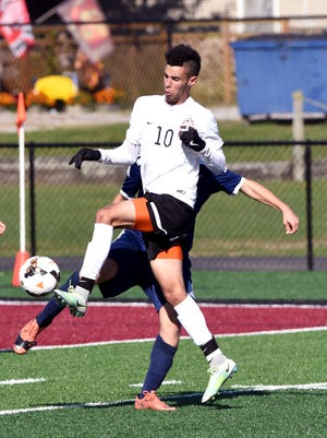 Michael Gibson tries to maintain possession during a 2-1 against Grandview Heights in its Division IV regional final game last year at Newark. Gibson will play at Marietta College next season.
