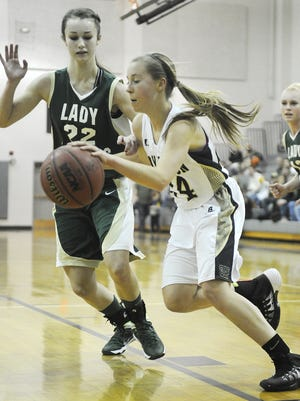 Buffalo Gap's Shelby Stenzel dribbles the ball as Wilson's Lexi Deffenbaugh guards her during the girls' basketball game on Friday, Jan. 17, 2014, in Swoope.