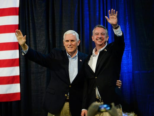 Pence and Virginia gubernatorial candidate Ed Gillespie wave during a campaign rally at the Washington County Fairgrounds on Oct. 14, 2017, in Abingdon, Va. Sara D. Davis, Getty Images
