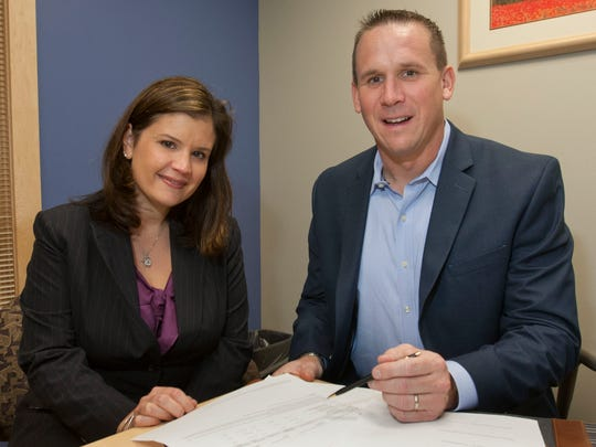 Lauren Kelly and Ryan Zacharczyk are the business partners behind Zynergy Retirement Planning in Middletown.