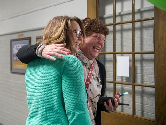 Washington Middle School Principal Michele Branson-Bopp embraces special education teacher Jennifer Stoll during a reception to celebrate Branson-Bopp's 2018 Building Principal of the Year award, Wednesday morning, April 4, 2018. The 27th annual awards honor the dedication and contributions of Vanderburgh County K-12 educators at public and nonpublic schools that have at least three years in the profession.
