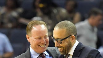 Oct 6, 2016; Memphis, TN, USA; Memphis Grizzlies head coach David Fizdale (R) greets Atlanta Hawks head coach Mike Budenholzer (L) after their game at FedExForum. The Hawks won 104-83.